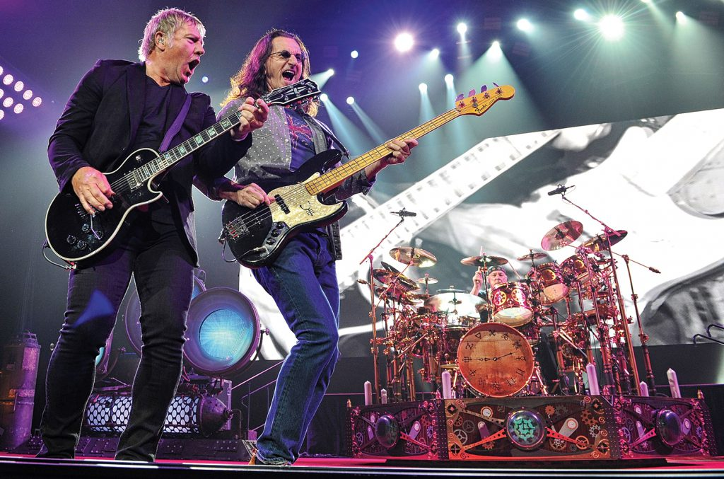 Rush — Lifeson, Lee and Peart (from left) — onstage at Nashville's Bridgestone Arena in 2013. Photo by Frederick Breedon/Getty Images