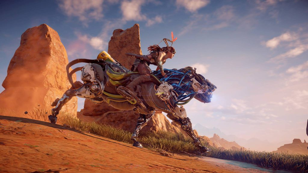 "Aloy riding a Strider off into the sunset in ""Horizon Zero Dawn"" game."