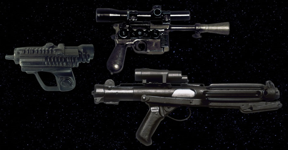Three examples of Star Wars blasters.