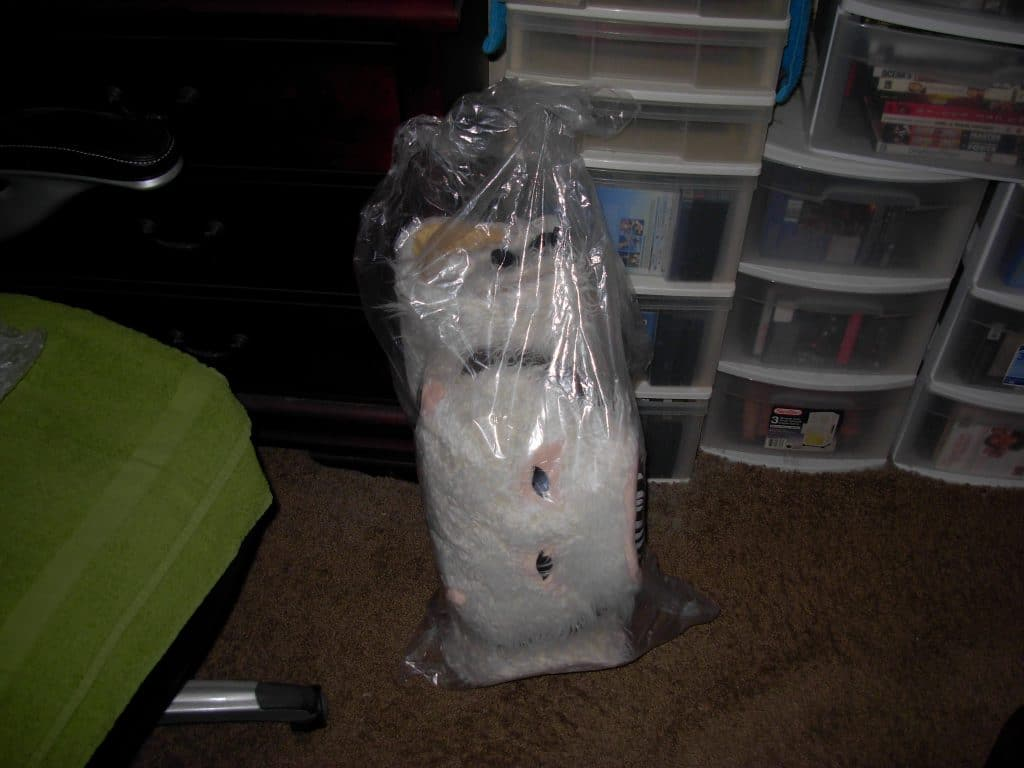 Wampa rug rolled up in a bag.